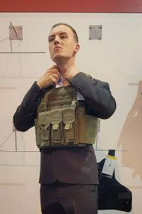 Team photo of Joel wearing his military tactical vest